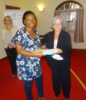 Joy Adiele receives AWARD certificate